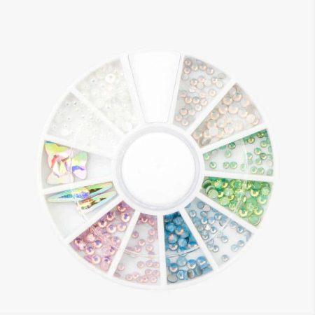 O carrossel de nail art Unicorn Rhinestones oferece-lhe 306 pedras e pérolas brilhantes. Um verdadeiro tesouro para decorar as unhas!